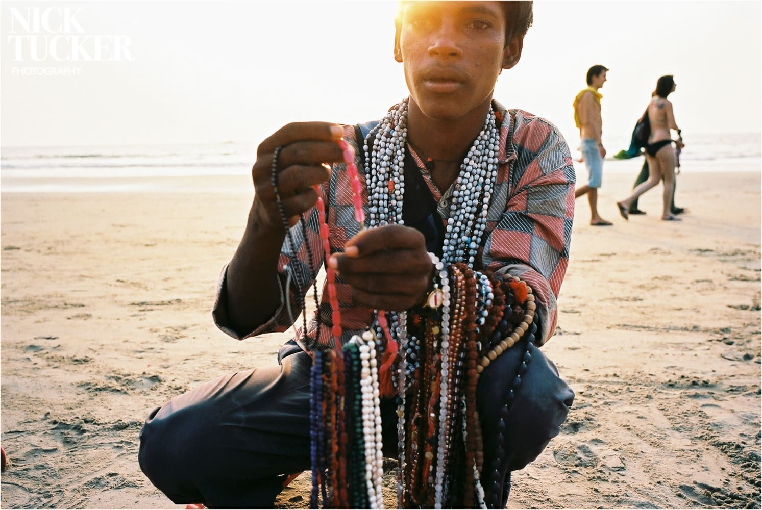 young indian bead seller