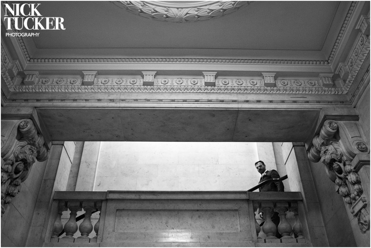 groom on the steps inside marylebone town hall
