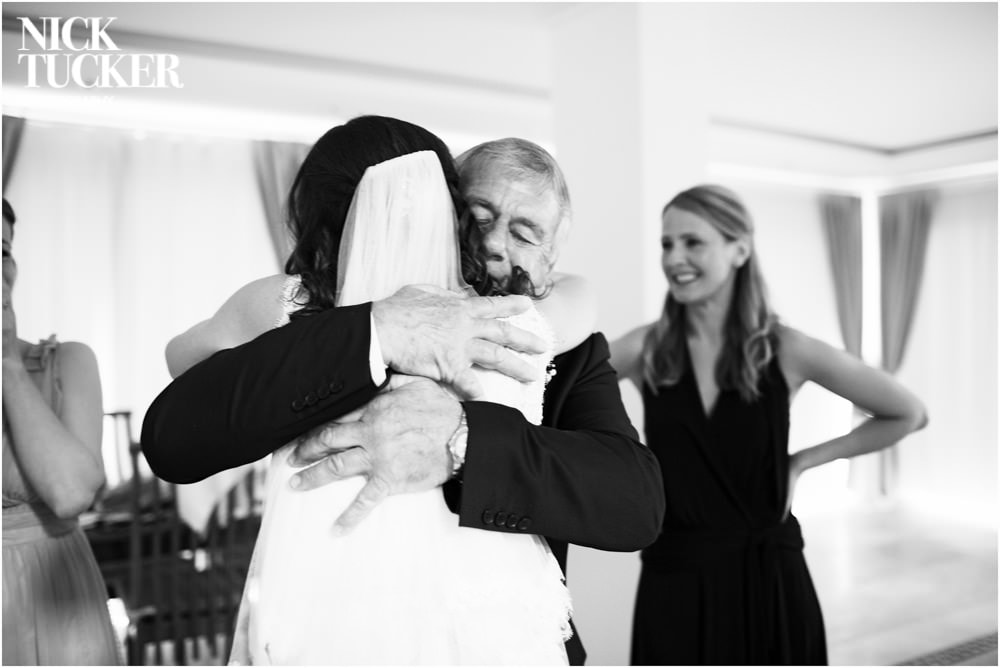 father and daughter hug before wedding