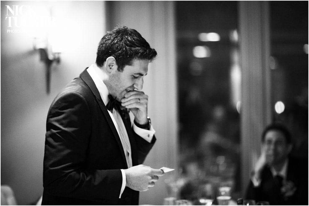 nervous groom reading wedding speech
