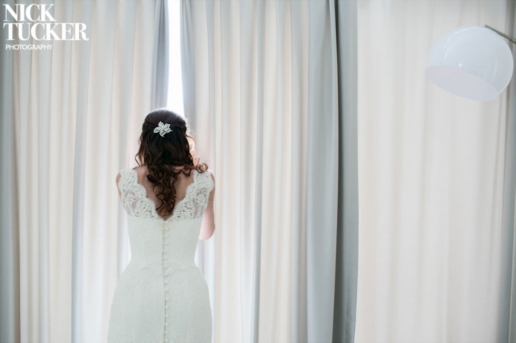 bride peeking out curtains